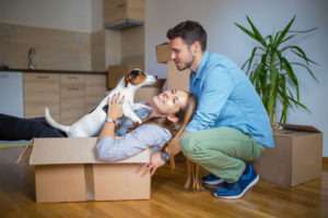 couple who just moved in playing with their dog