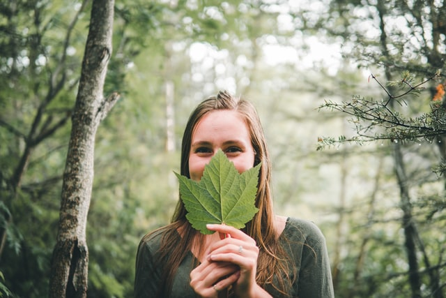 Woman with Leaf in forest