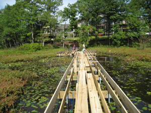 Patriot Place Boardwalk in MA with helical piles for foundation support