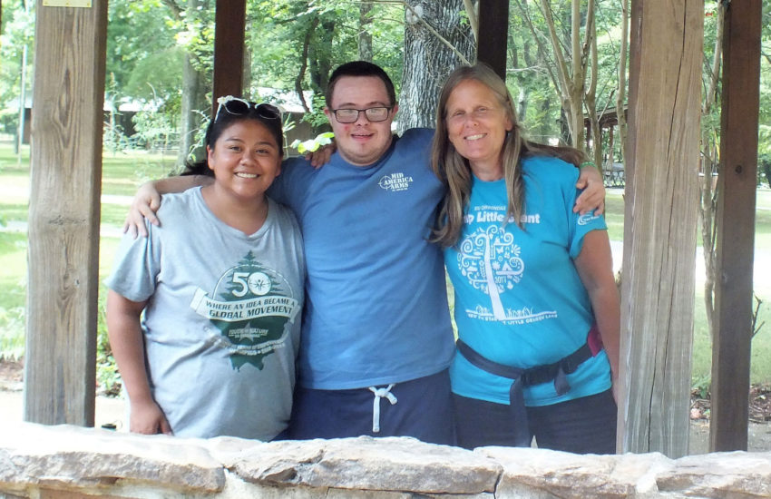 Two campers posing with female counselor