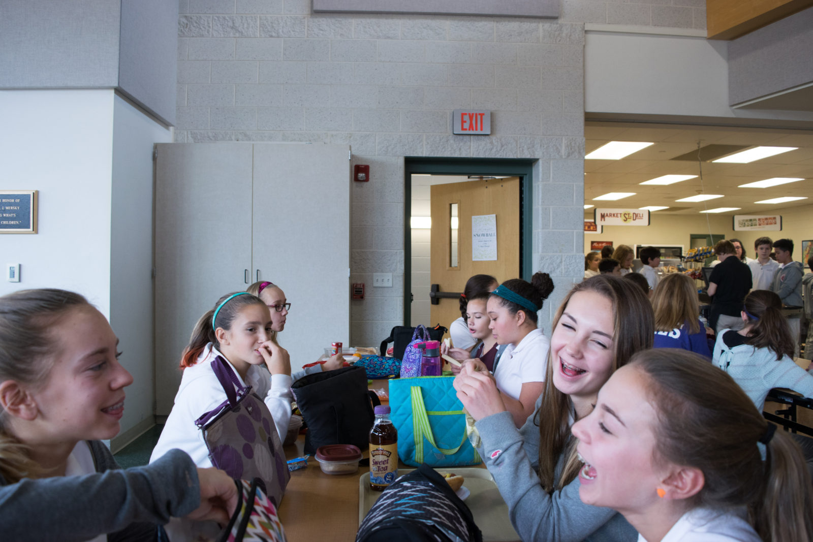 Middle Schoolers enjoy lunch.