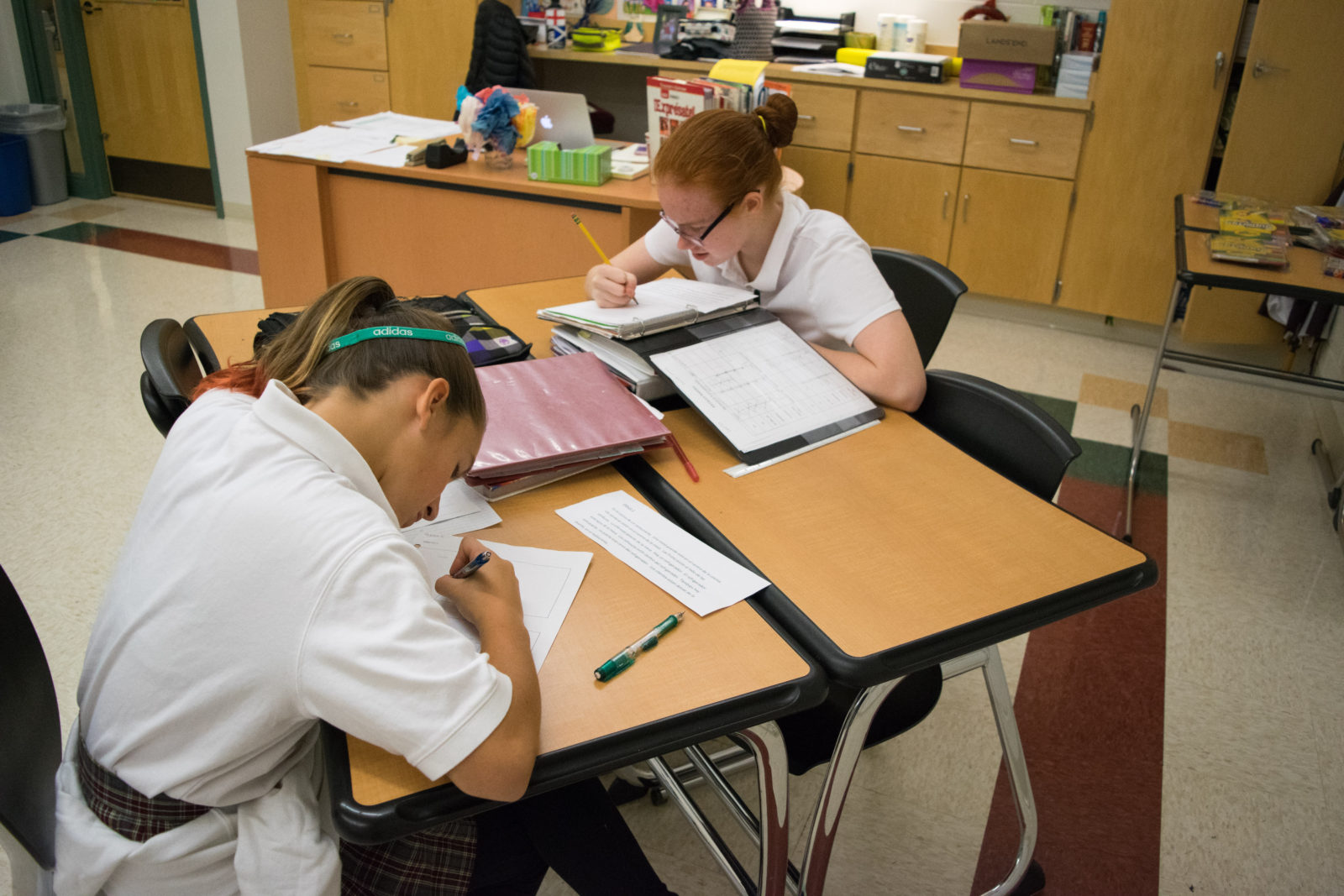 Alyssa K. and Laurel M. working diligently in Spanish class.