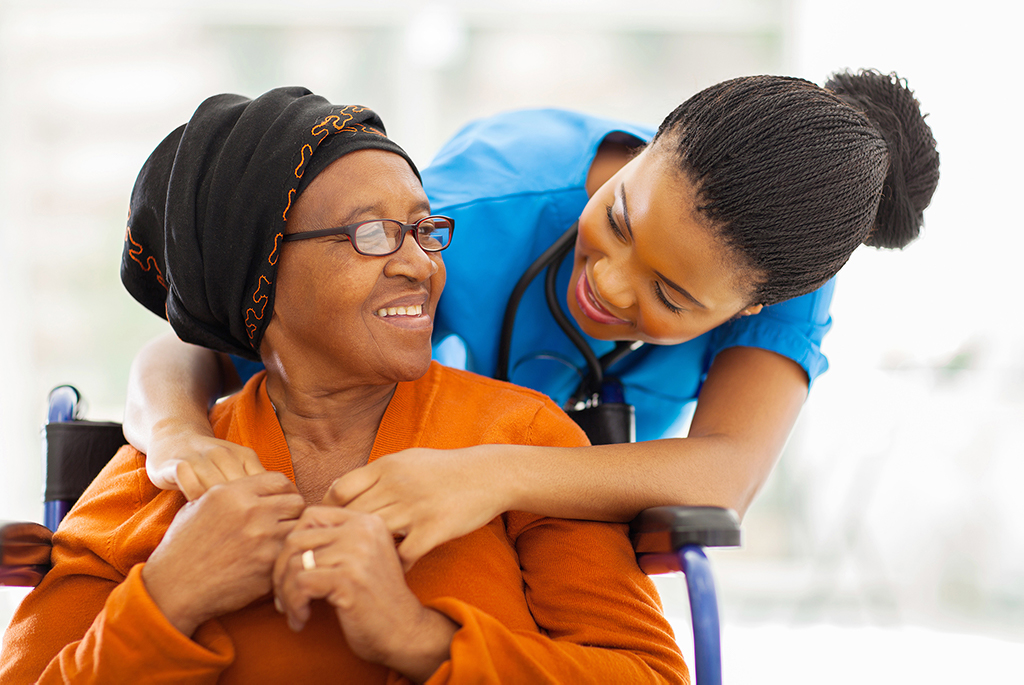 cna caregiver hugging senior woman