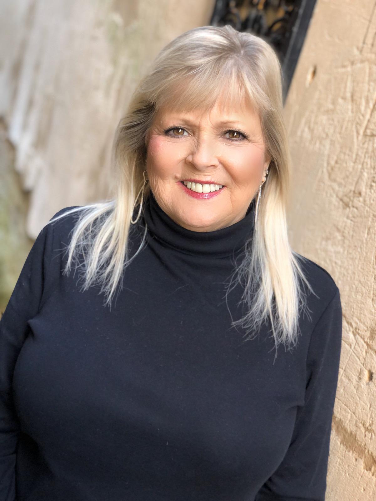 Sue Holland Bio