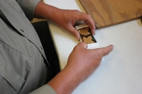 Roger Proulx boxes large maple leaf candies. Practiced hands get the job done swiftly.