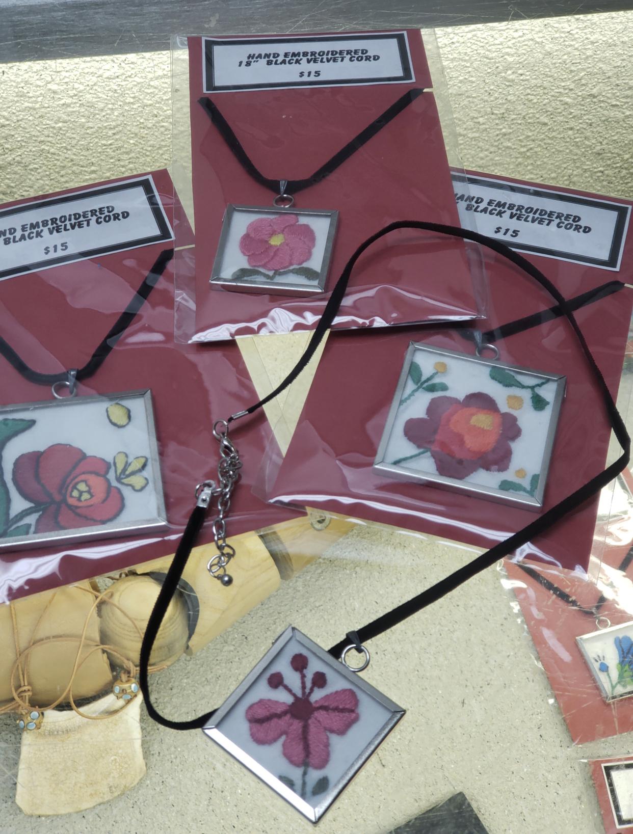 Embroidered folk art pendants $15