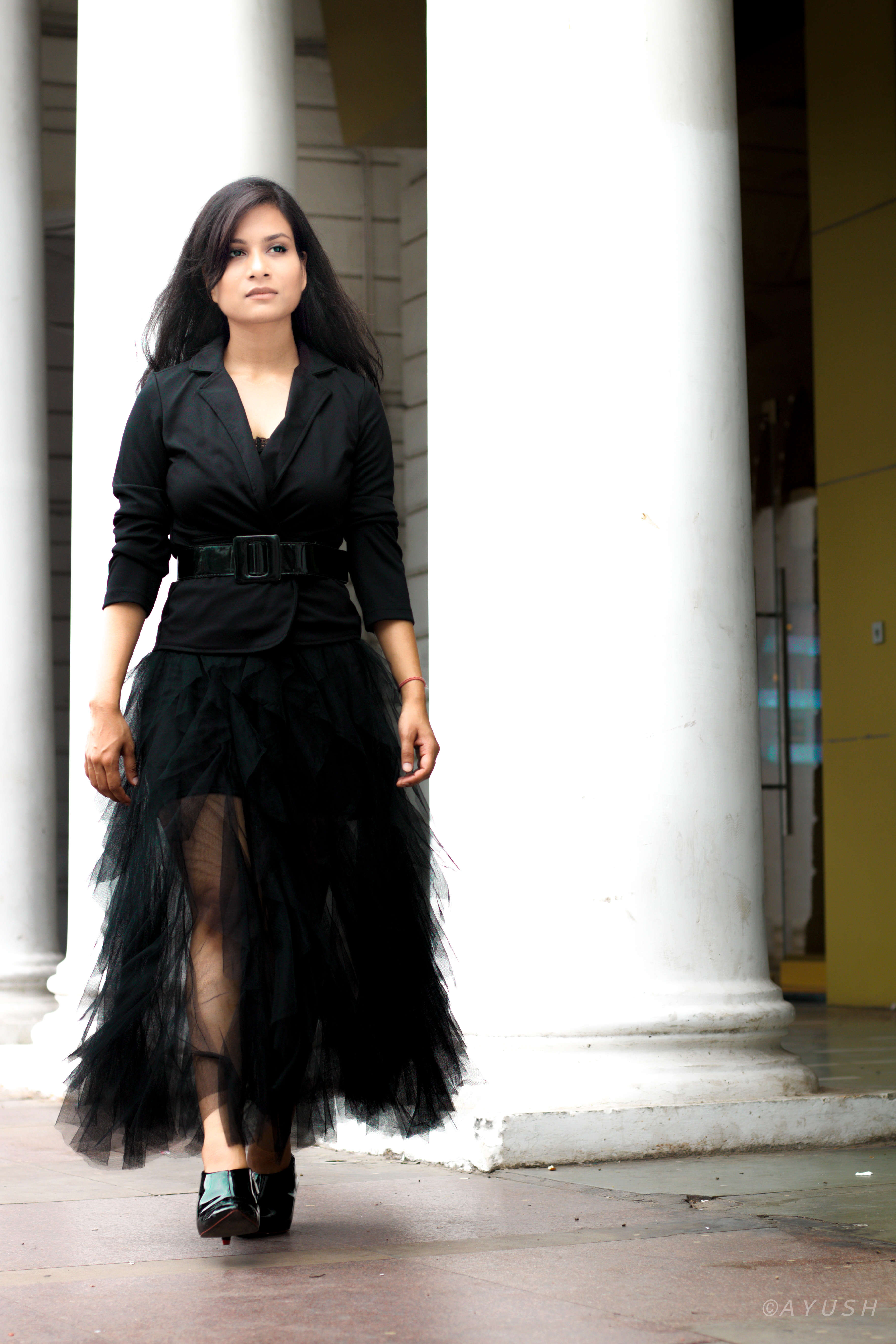 Styling the black tulle skirt with black blazer and waist belt