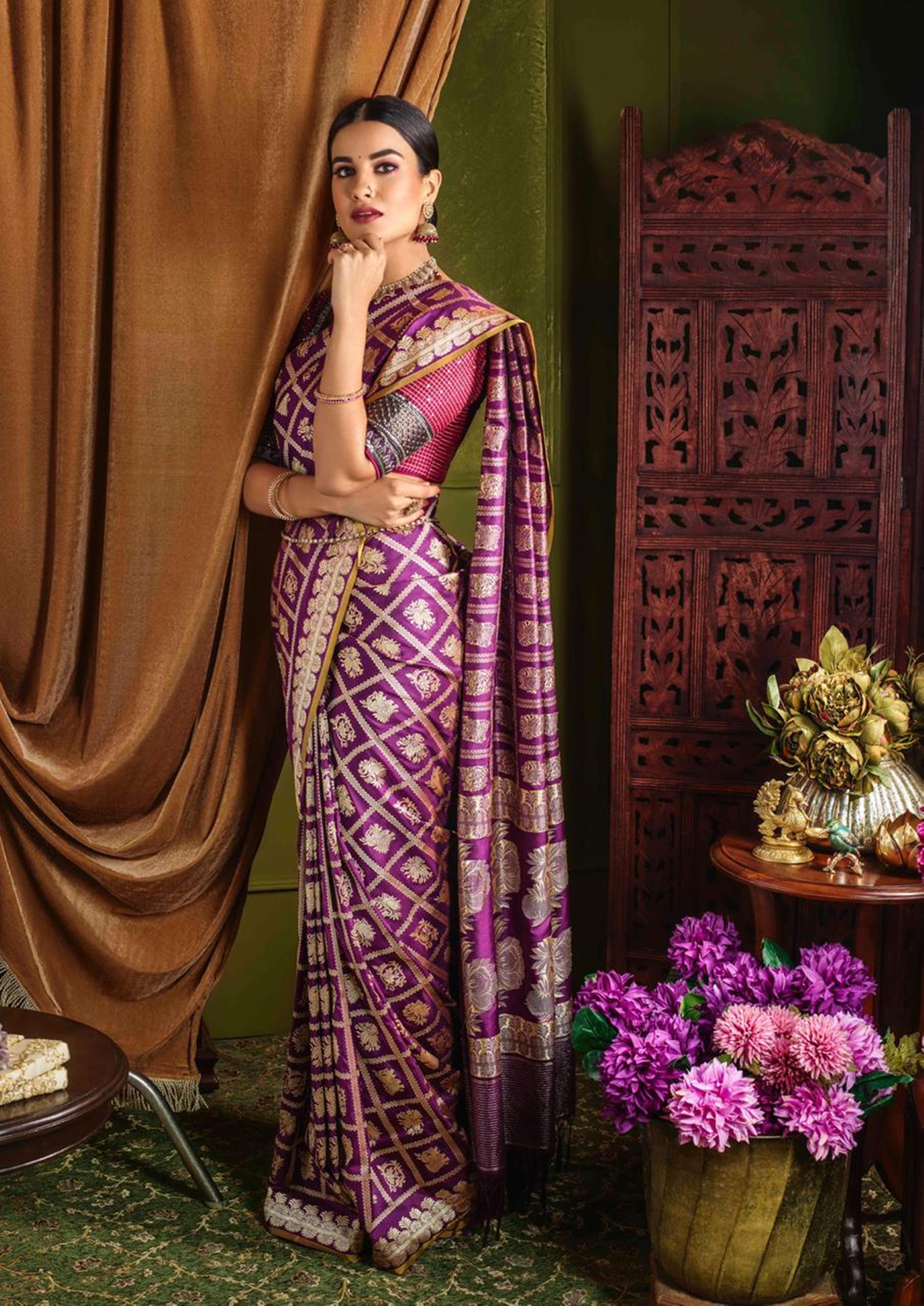 Model donning Maroon Banarsi Silk Saree by Kankatala