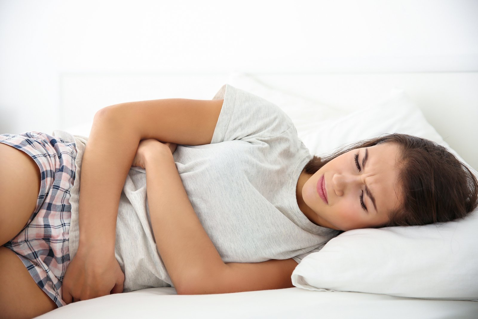 young woman with stomach pain