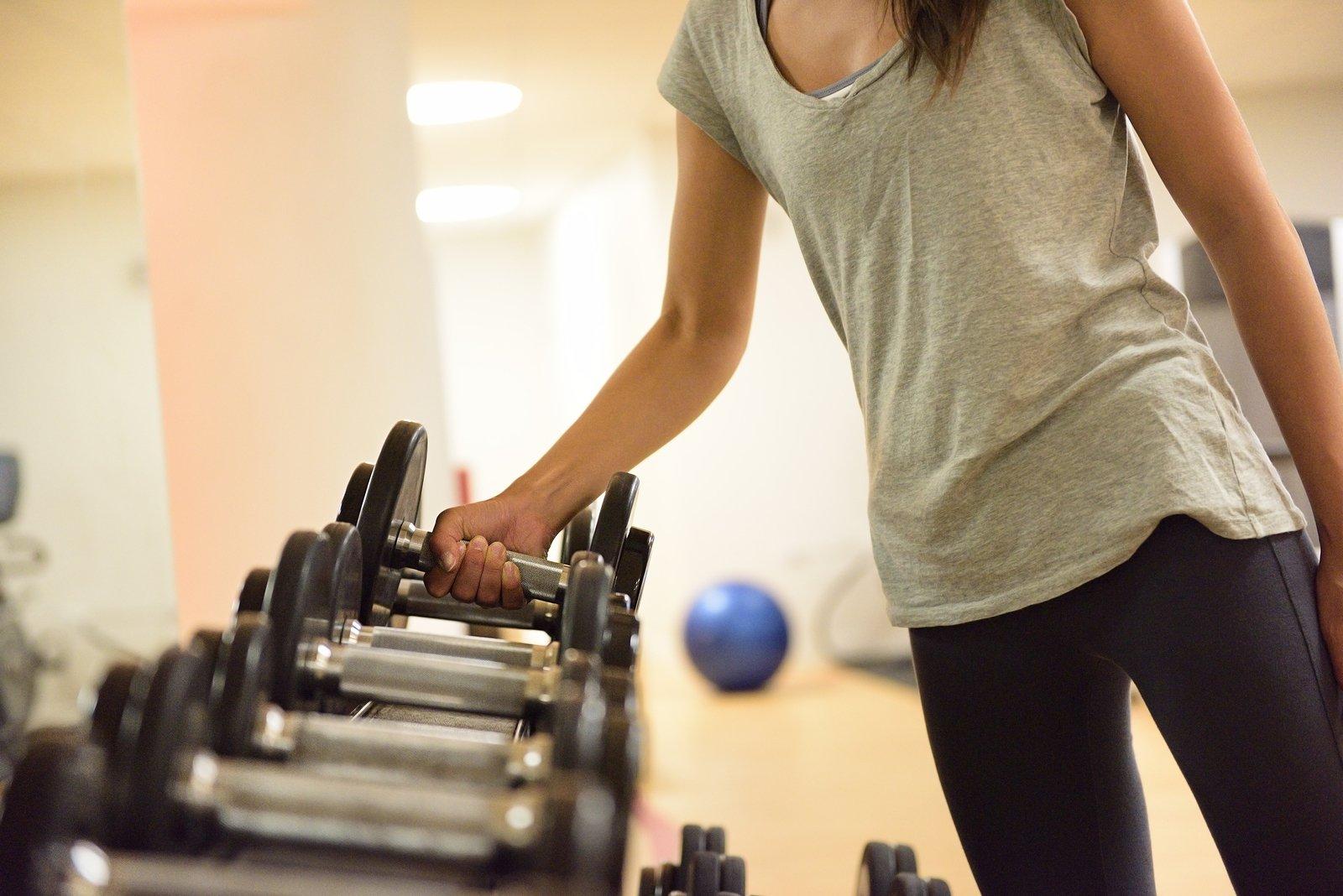 bigstock-Gym-woman-strength-training