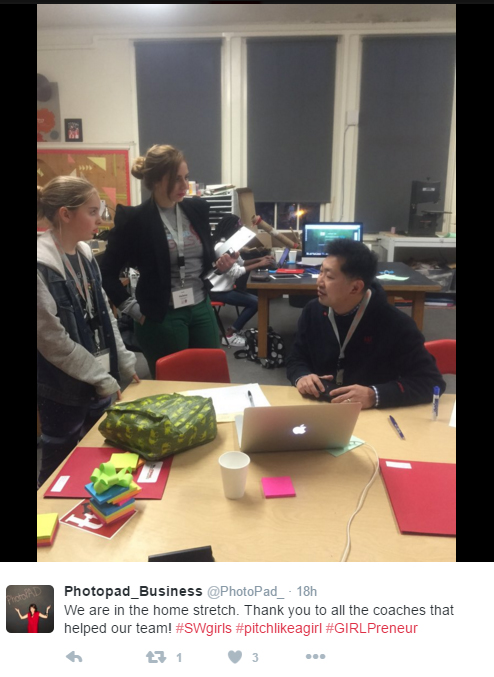 Anthony Tsim helps a group at Startup Weekend GIRLS