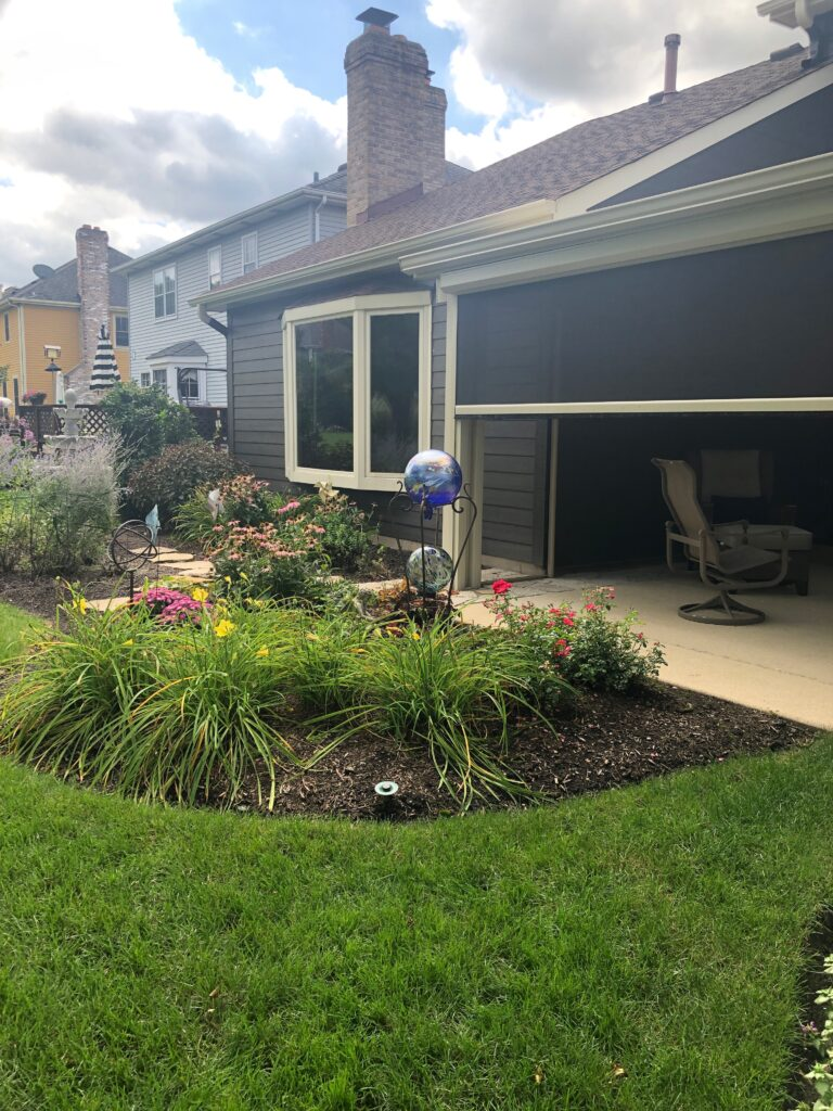 Landscaping off of screen room