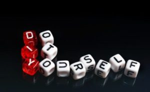 DIY Do It Yourself written on dices on black background