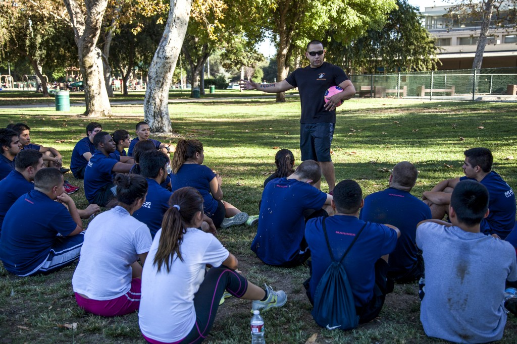 Sgt. Lopez leads a group of future and current recruits and educates them on different levels of income they may earn as they move up the ladder in the Marine Corps in Van Nuys, Calif. Photo: Lynn Levitt