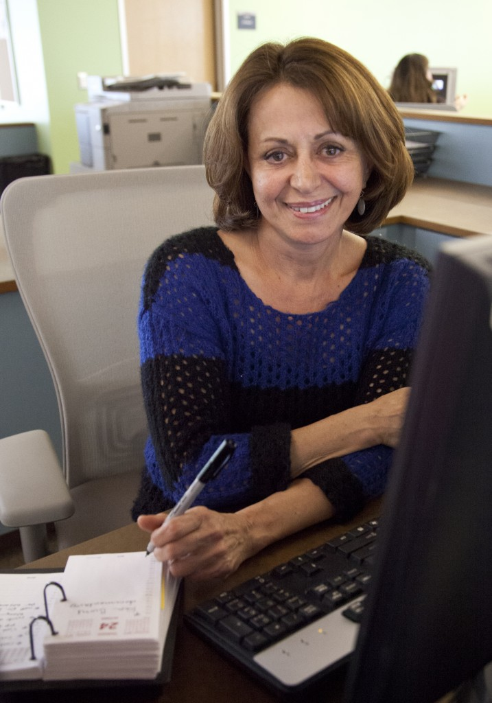 Zarrin Paidor, Educational Counceling office assistant sits at her desk, ready to assist anyone who needs help. Photo by: Lynn Levitt