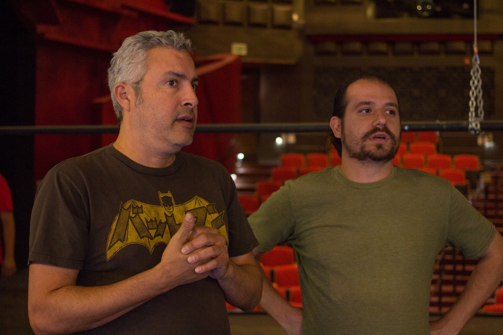 Edward Salas and Department Chair of Theatre and Dance Michael Gend discuss on solving a problem with a lighting fixture in the Performing Arts Building on Pierce College, Woodland Hills, Calif. Photo by: Alan Castro