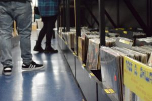 Shoppers walk through the rows of records that sit in bins at CD Trader. The record store is open Monday through Saturday, 10 a.m. to 8 p.m. and Sunday from 11 a.m. to 7 p.m. It is located at 18926 Ventura Boulevard, Tarzana, CA 91356 Phone: (818) 705-3544.