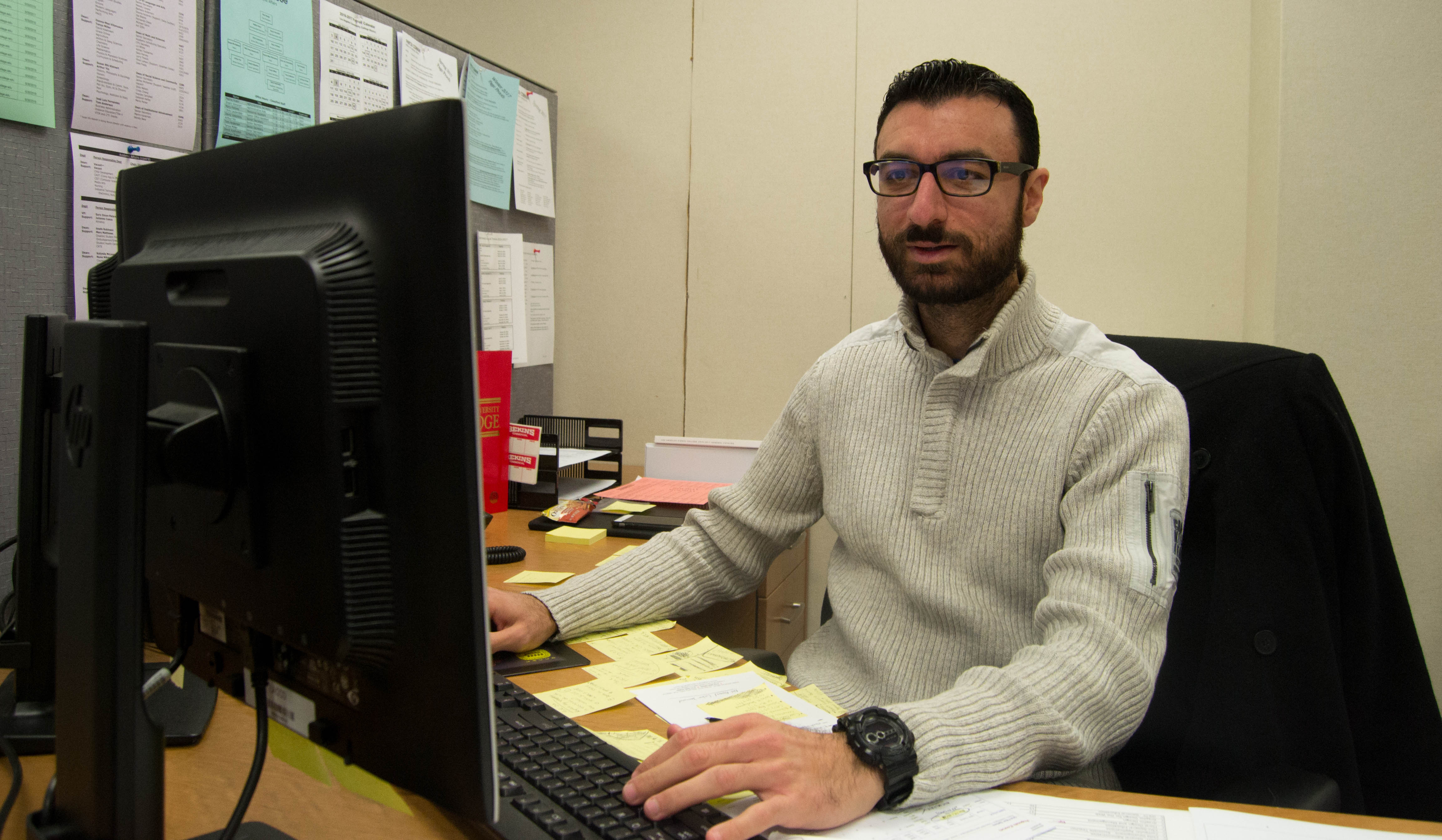 Shant Varozian working in his office at VGLE 8213 in Pierce College in Woodland Hills, Calif.