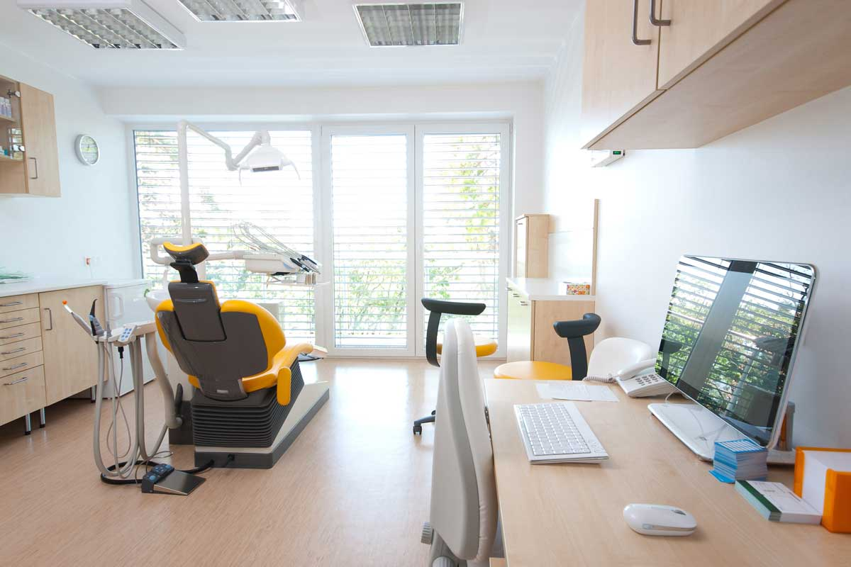 Commercial business gym interior painted white & tan