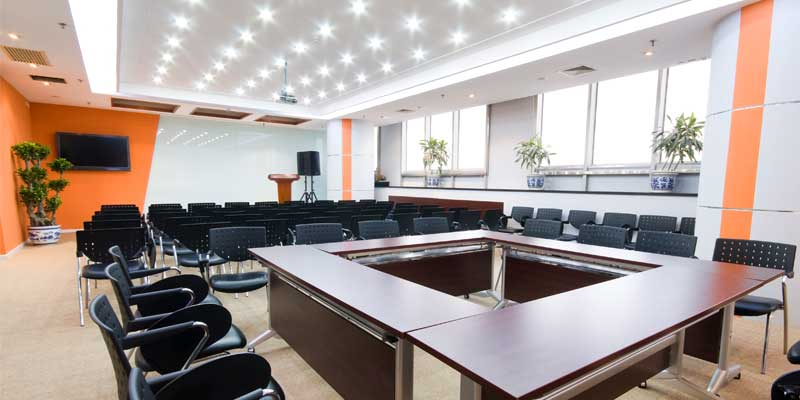 Interior Commercial Painting - Business conference room interior painted vibrant orange & white