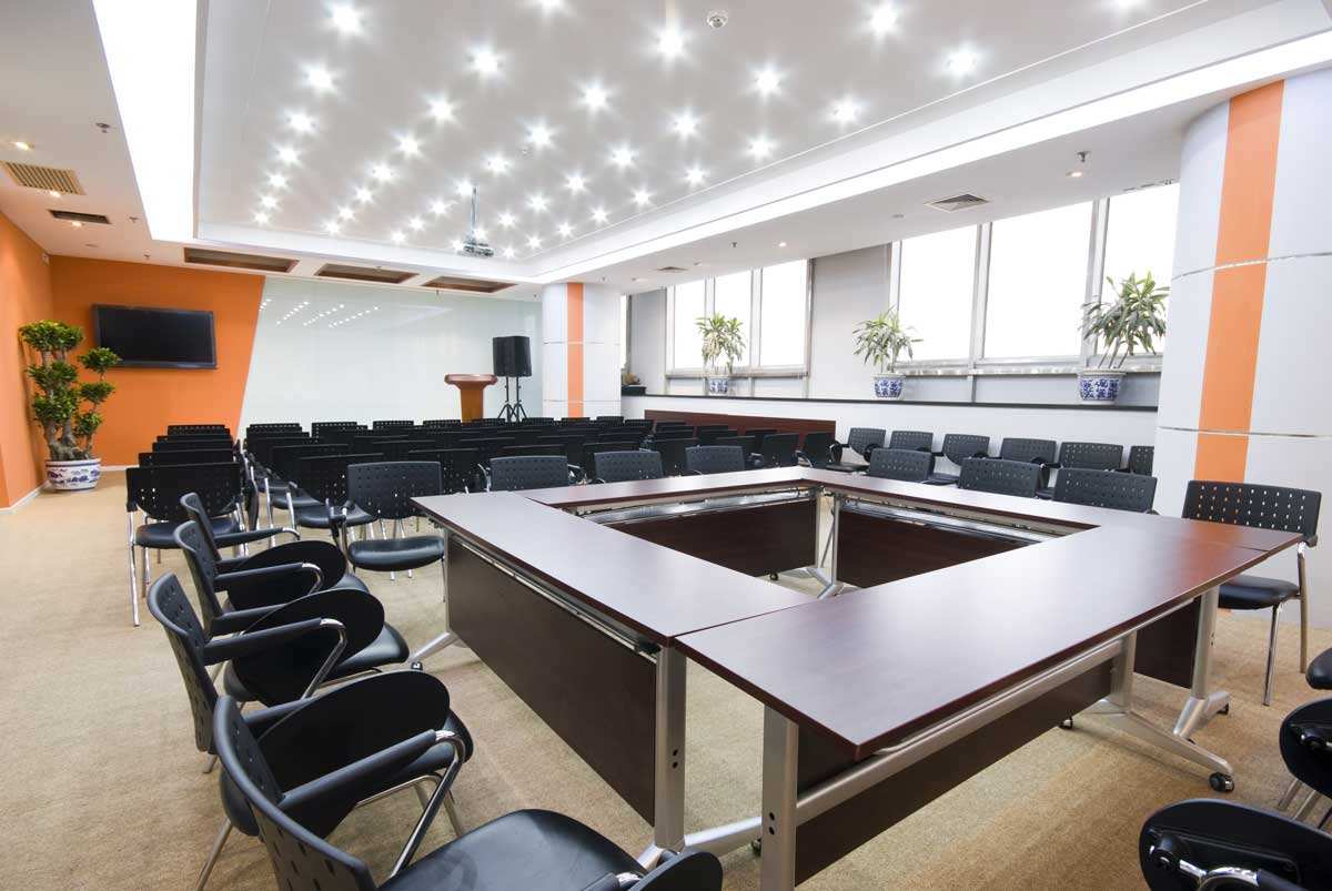 Commercial business conference room interior painted vibrant orange & white