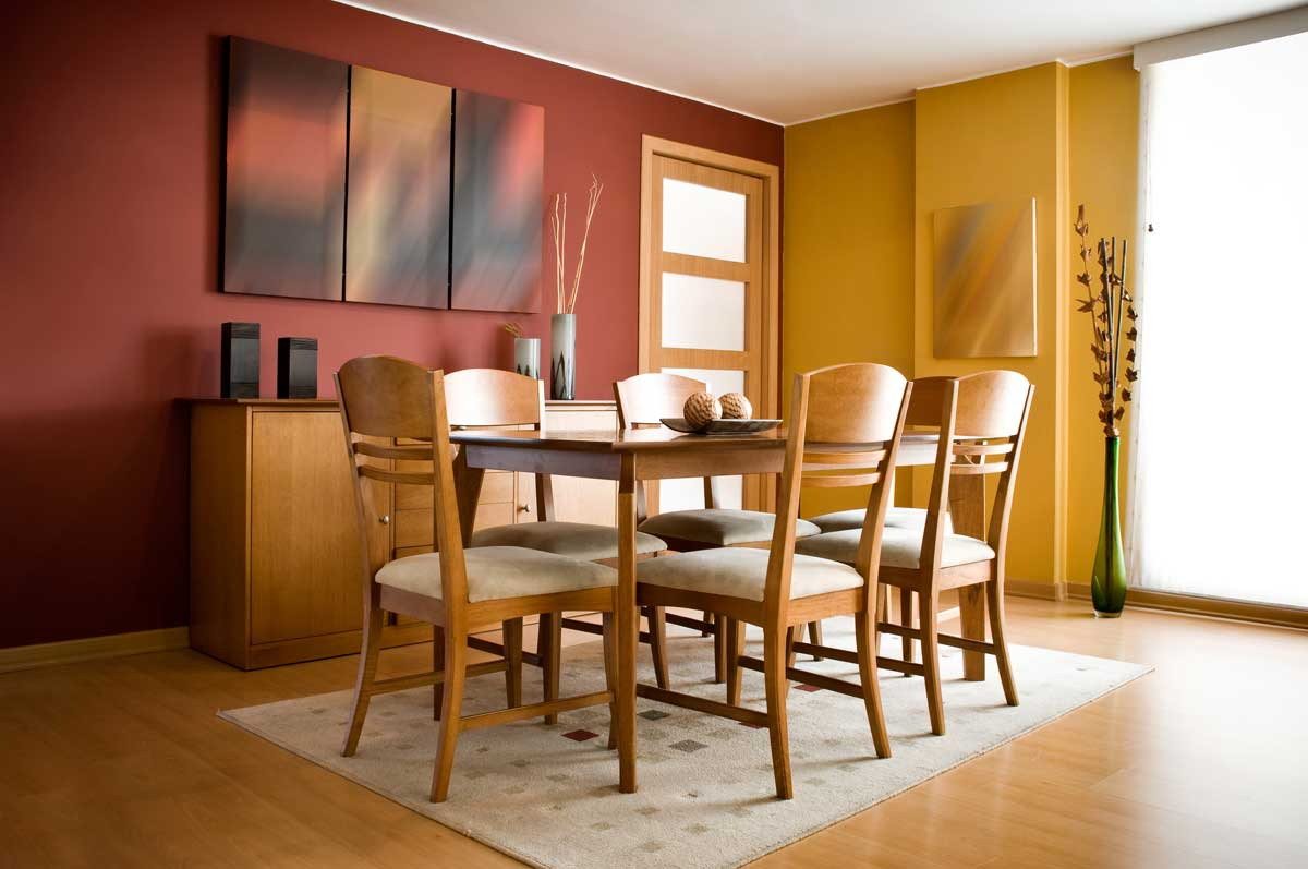 Residential home dining room interior painted dark red, white, and dark yellow
