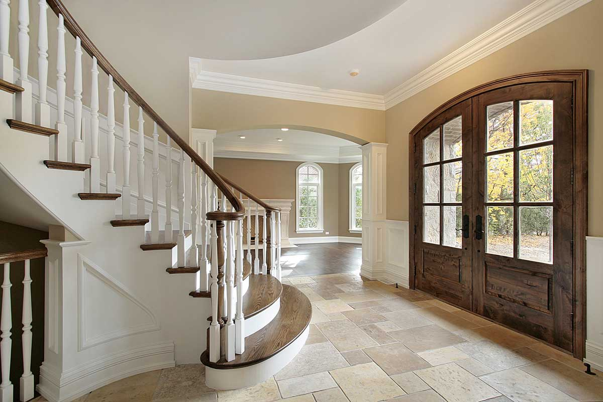 Residential home interior entrance painted white, beige, and brown