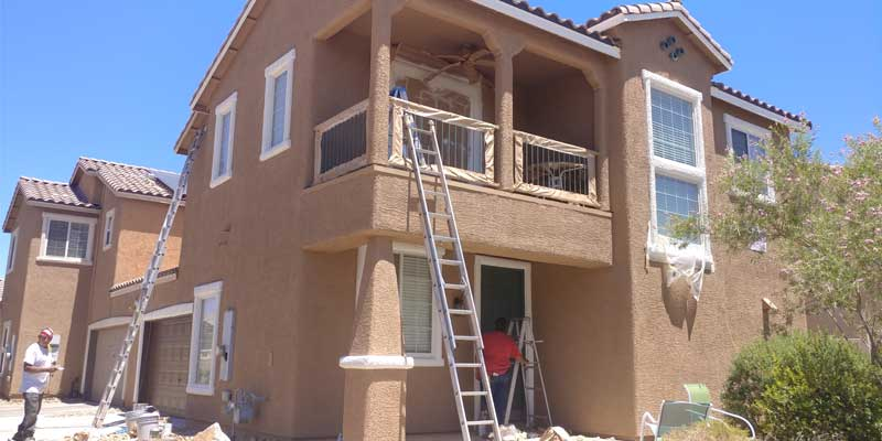 Property Management Painting - Apartment condo property exterior being painted dark tan & white