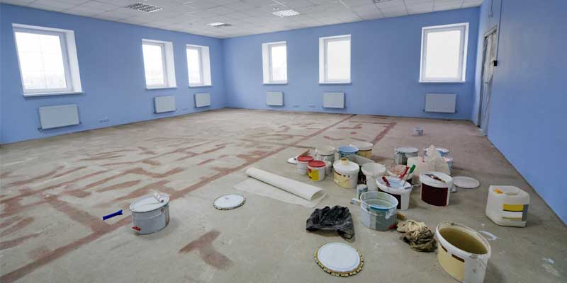 Property Management Painting - Commercial business office interior being painted blue & white