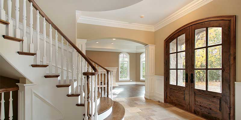 Property Management Painting - Home interior entrance painted white, beige, and brown