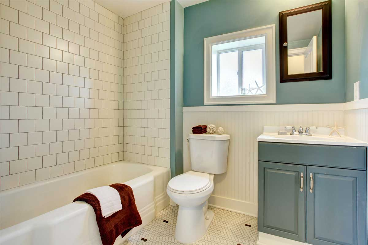 Residential home bathroom interior painted teal & white