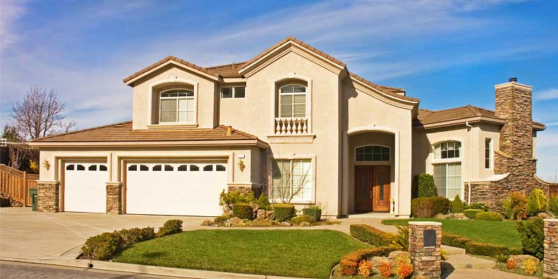 Exterior Residential Painting - Home exterior painted desert beige & tan