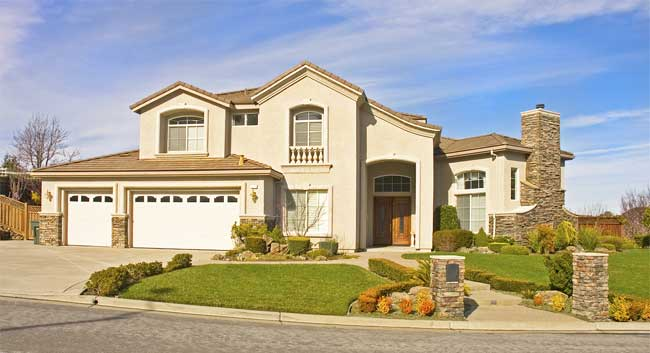 Residential home exterior painted desert beige & tan