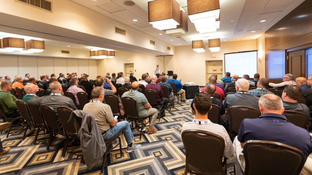 CONFERENCE SESSION FILLED WITH ATTENDEES
