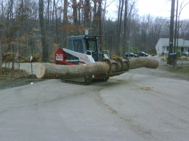 Carroll Bros. Contracting Moving logs to haul to the lumber mill - Crofton, MD
