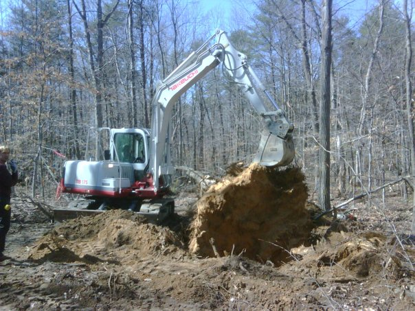 Carroll Bros. Contracting Digging out a large poplar stump - Crofton, MD