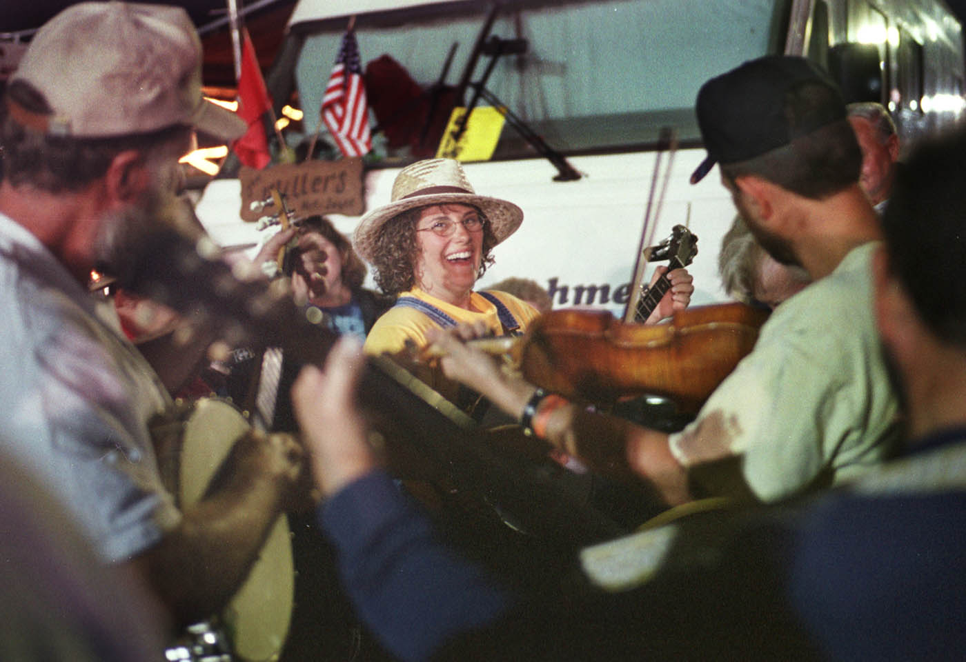 Trish Kilby, center, from Lancing, NC, was obviously having a great time picking banjo with The Blue Ridge Ramblers as they played in the campground area during the 67th Annual Old Fiddlers Convention in Galax, VA  Friday night,  August 9, 2002.    NOTE: FOR RT. 58 PROJECT.