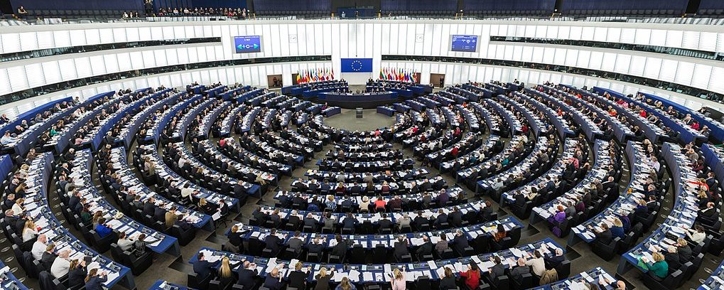 The Hemicycle of the European Parliament in Strasbourg during a plenary session in 2014. Wikimedia Commons.