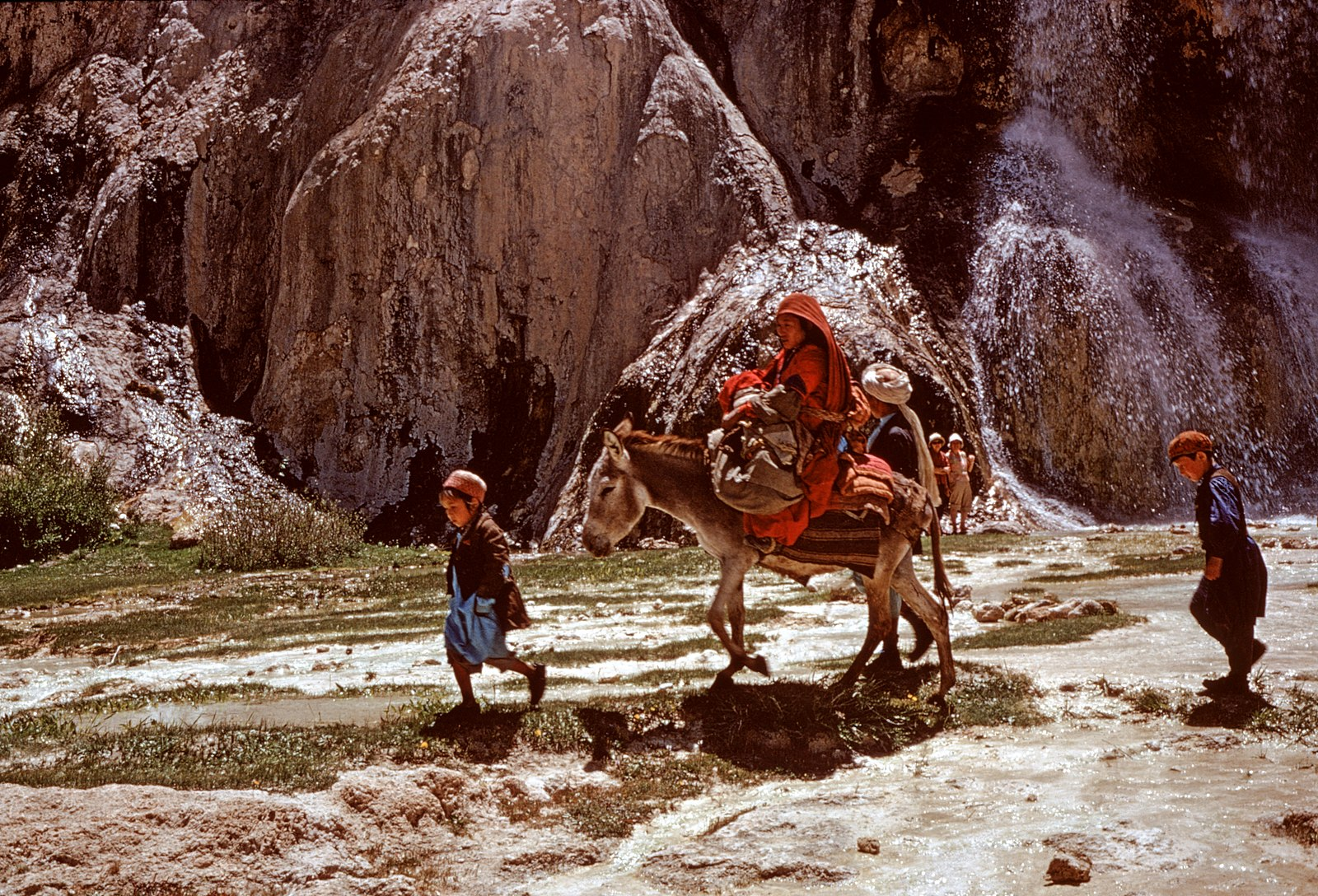 Hazara family, woman and children on donkey back, Band-i-Amir, photo by Françoise Foliot, 1974-1975, Creative Commons Attribution-Share Alike 4.0 International license