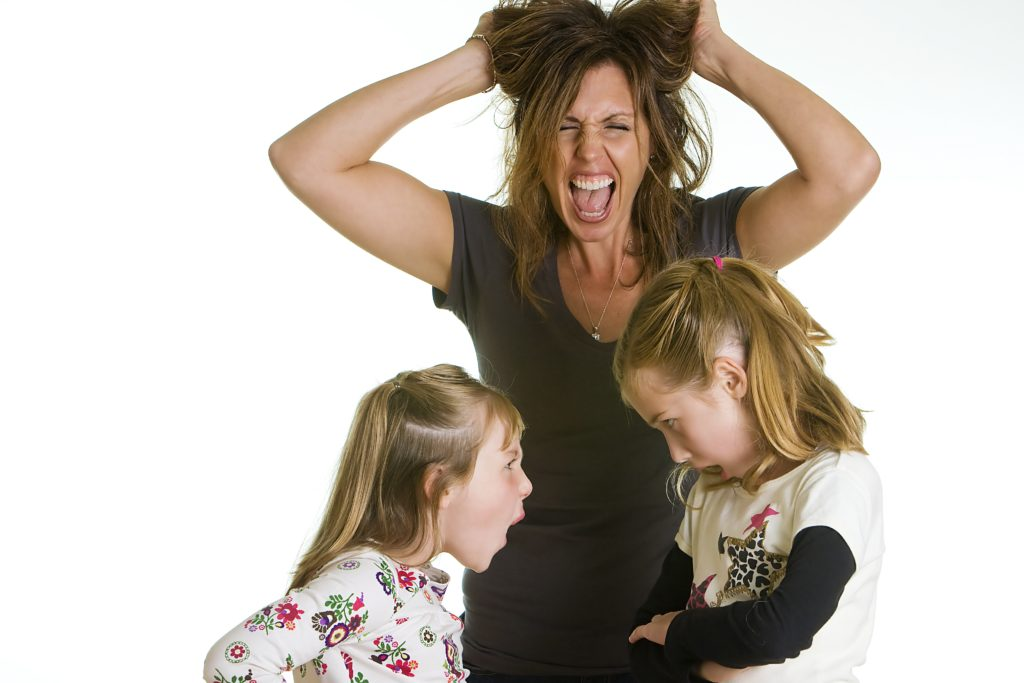 Mom pulling own hair and screaming while two young girls bicker