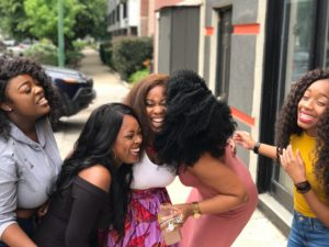 females sharing laughter and friendship