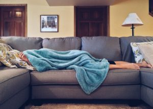 woman napping turquoise blanket