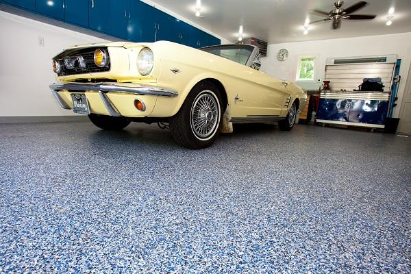 yellow car parked on polyurea garage floor coating in los angeles