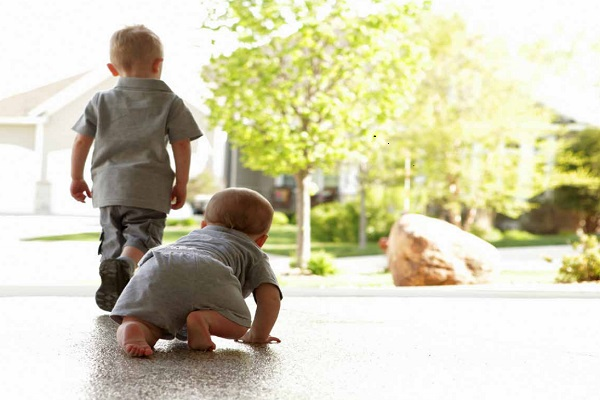 two kids playing on polyurea garage floor