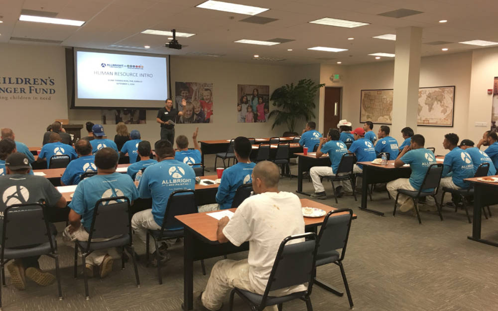 picture of ALLBRiGHT 1-800-PAINTING's President Josh Abramson leading a company meeting