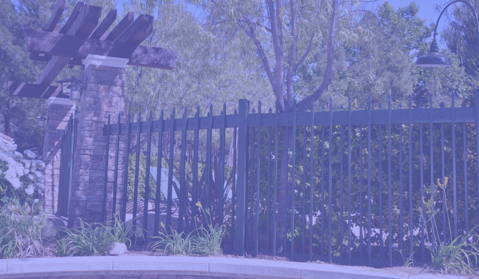 wrought iron fence that has been freshly painted