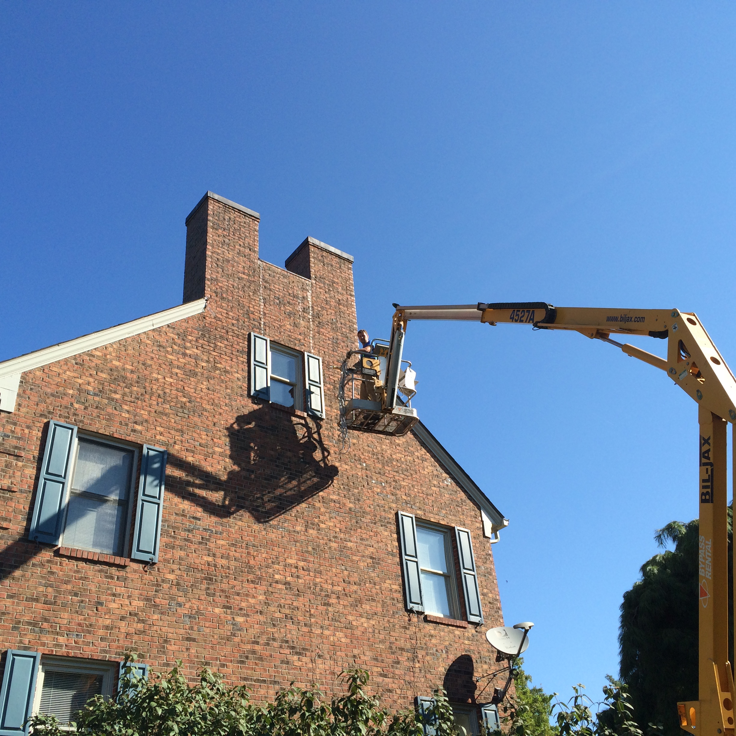 Chad conducting a bat exclusion on an aerial lift