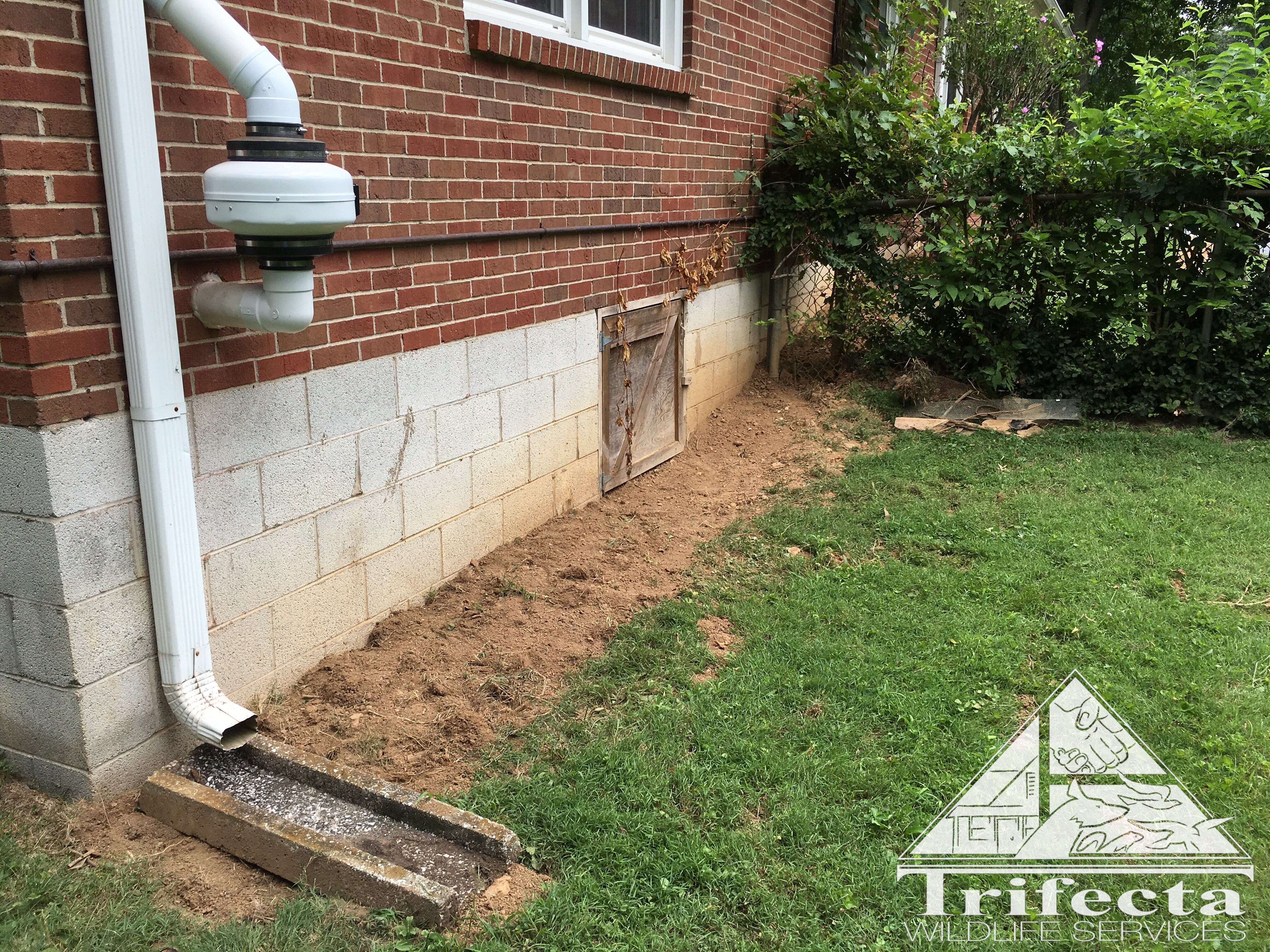A completed traditional dig barrier install