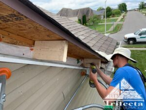 Tim installing cross braces for the new fascia board to secure to