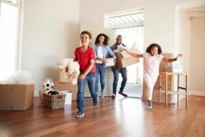 Defining Dreams and Goals At Work and In Life - family moving into newly purchased home